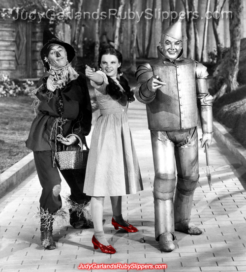 Judy Garland as Dorothy wearing the ruby slippers