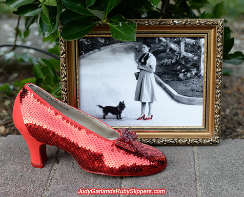 Sequining is in progress on the right shoe of the ruby slippers