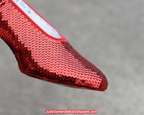 Sewing the sequins on the ruby slippers to a high standard