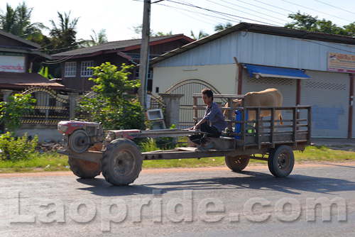 Tractors traveling on the outskirts of Vientiane, Laos