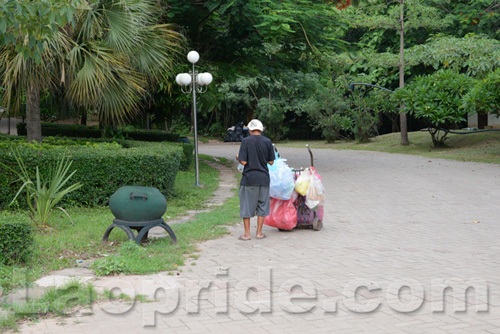 Vietnamese man collecting cans and bottles in Vientiane, Laos
