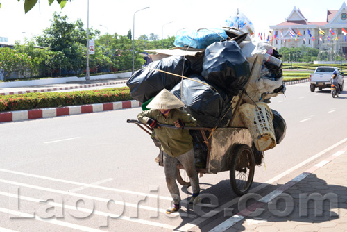 Vietnamese woman collecting trash to sell in Laos