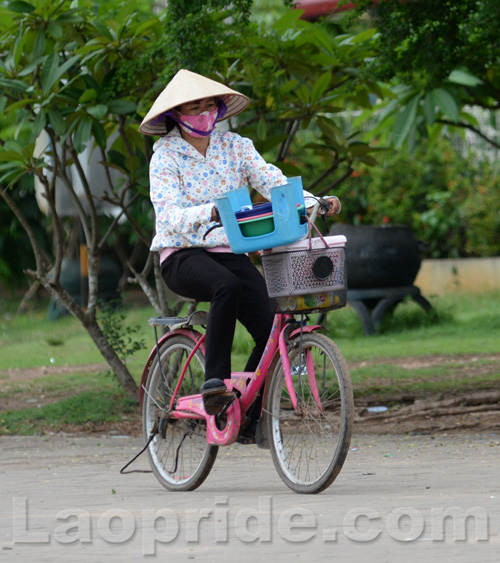 Vietnamese women working on bicycles in Vientiane, Laos