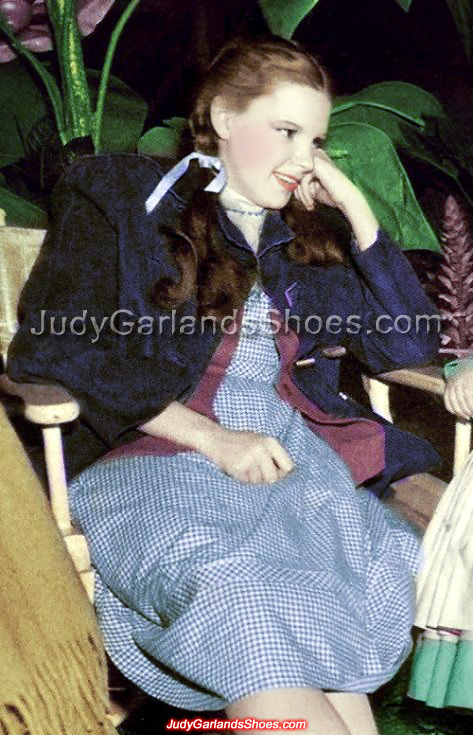 Candid photo of Judy Garland as Dorothy relaxing on the set