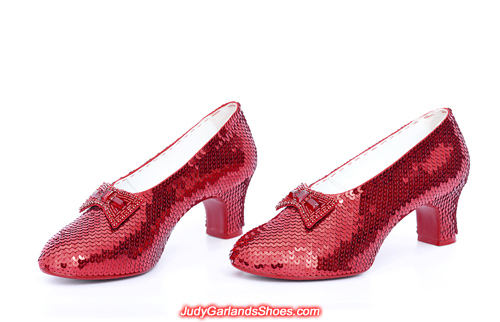 Exquisite pair of hand-sewn ruby slippers in Judy Garland's size