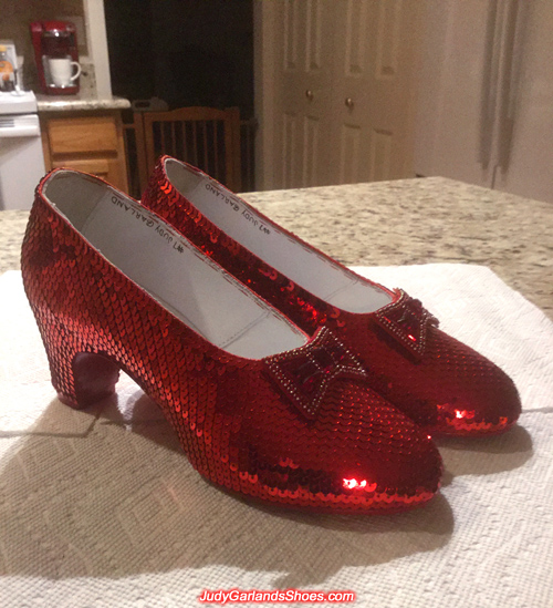 Hand-sewn ruby slippers at their new home
