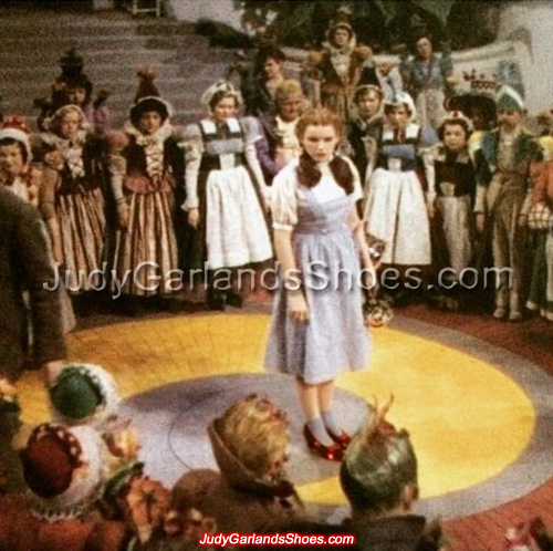 Judy Garland as Dorothy behind-the-scenes on the set of Munchkinland