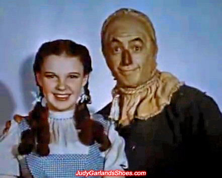 Judy Garland as Dorothy with the Scarecrow