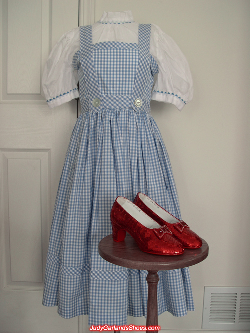 Judy Garland as Dorothy's dress and ruby slippers