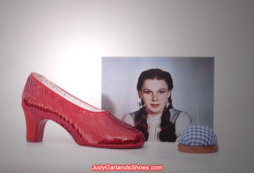 Judy Garland as Dorothy's right shoe is being sequined