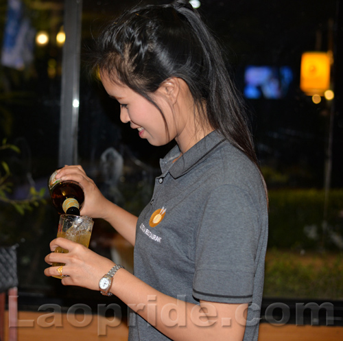 Lao beer serving girl in Vientiane, Laos