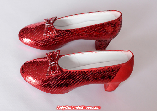 Sewing the sequins continues on Judy Garland's ruby slippers
