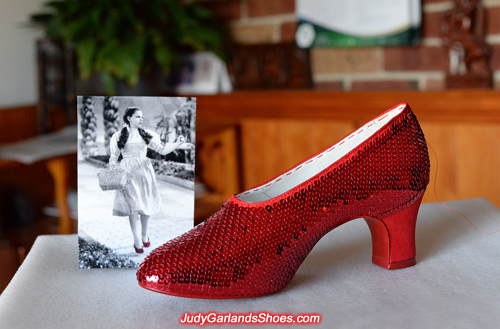 Working on the right shoe of Judy Garland's ruby slippers