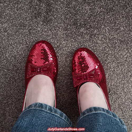 Woman wearing her size 6 ruby slippers